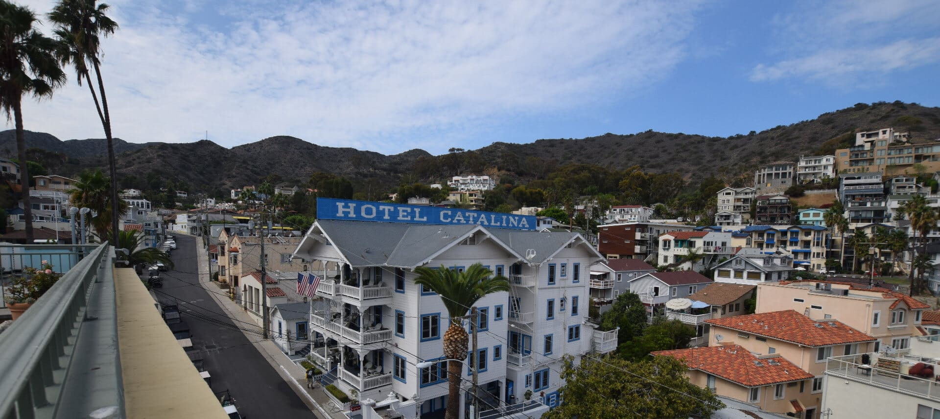 Overhead view of large white building with a blue sign saying Hotel Catalina